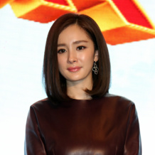 Mi Yang wearing Riva cluster earrings and Baja bracelet